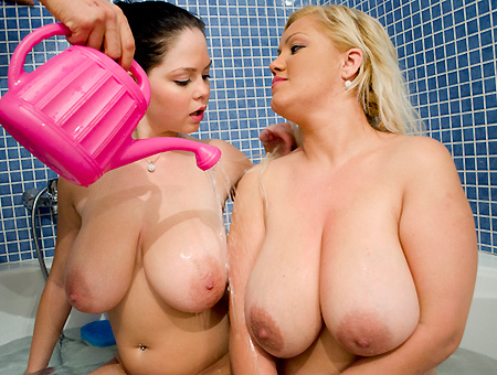 Two busty women get hot in the bathroom and fuck